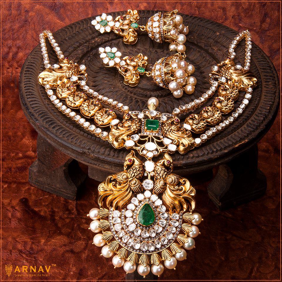 Designer gold jewellery set necklace and jhumkas - Jewellery Designs