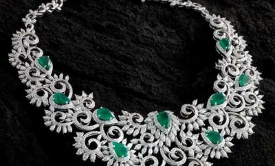 diamond necklace with emeralds and white gold