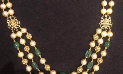 pearl chain designs traditional model in gold and emerald beads