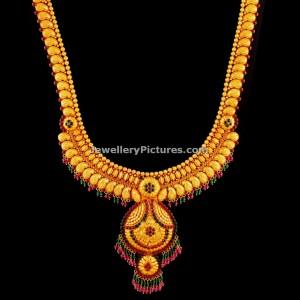 antique-gold-mango-haram-with-pendant-design