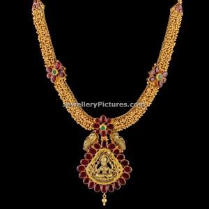 gold-pusalu-antique-gold-haram-designs